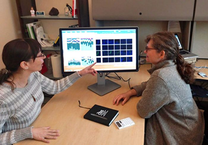 ARS scientists Danielle Lemay (right) and Zeynep Alkan review microscope images and data from SAMSA2 software.